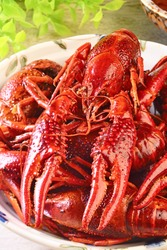 A plate of cooked  chinese food spicy crayfish.