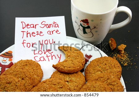 A plate of cookies and a cup of milk, intended for Santa, but a bite has been taken out of one of the cookies. A note for Santa has been left by little Cathy.