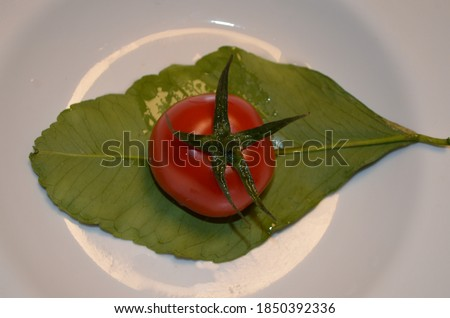 a plate of decorated tomatoes