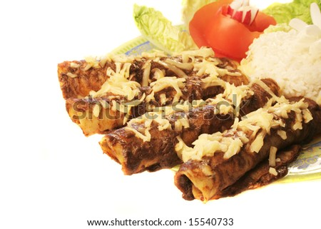 A plate of delicious enchiladas with rice