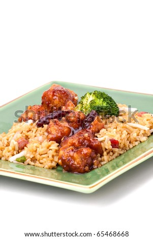A plate of General Tso's chicken with broccoli and pork fried rice isolated on a white background.