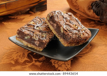 A plate of gourmet brownies with chocolate fudge and coconut