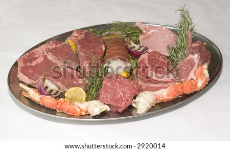 A plate of meat and seafood