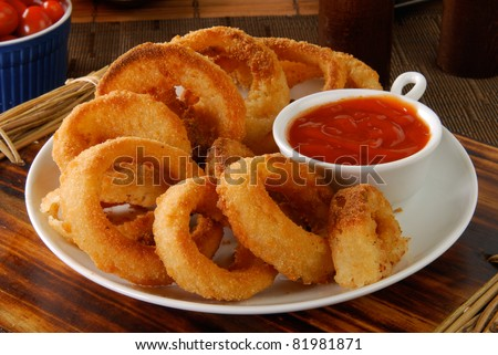 A plate of onion rings with catchup