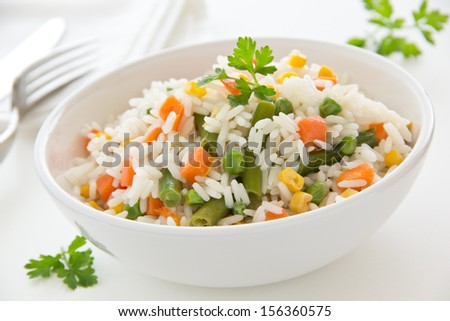 A plate of rice with vegetables Selective focus