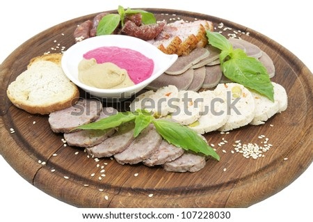 a plate of sausage and bacon on white background
