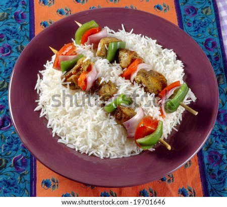A plate of shashlik with rice