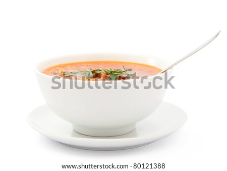 a plate of soup on a white background