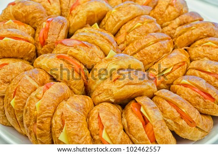 A plate of veggie croissants for catering events. - stock photo