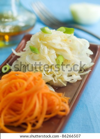 A plate with cabbage and carrot salad. Selective focus