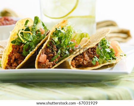 a platter of three tacos