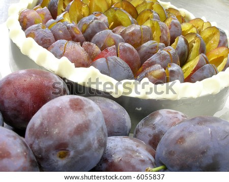A plum pie is ready for oven - stock photo