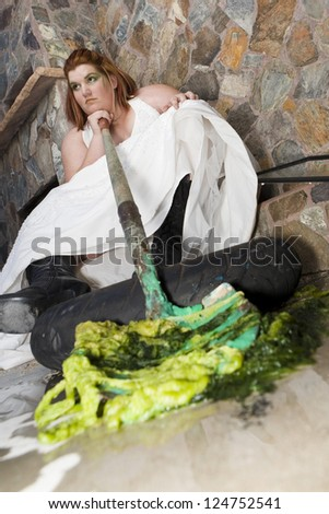 A plus size bride trashes her wedding dress with green paint