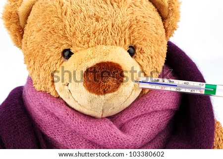 a plush bear with a thermometer in your mouth. representative photo of chills, fever and flu
