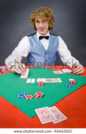 A poker player facing the dealer over a stack of chips during the flop