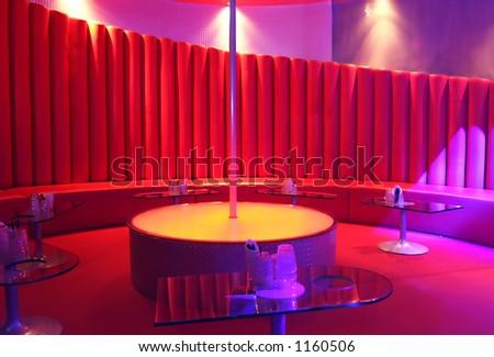 A pole in an empty night club.