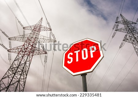 a poles of a power line and a stop sign. photo icon for phasing out nuclear energy