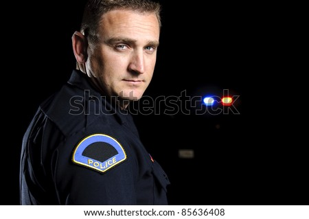 a police officer in the night.