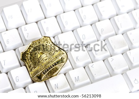 A policeman's badge on a computer keyboard