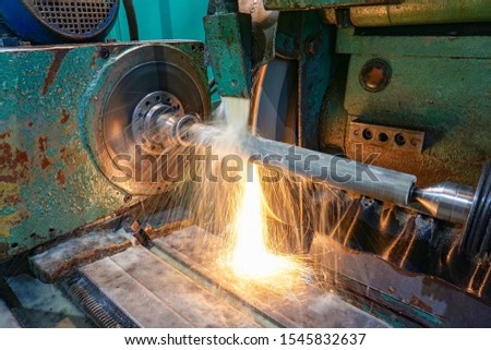 A polished shaft with a cooling emulsion is installed in the centers of a circular grinding machine and is machined with an abrasive wheel.