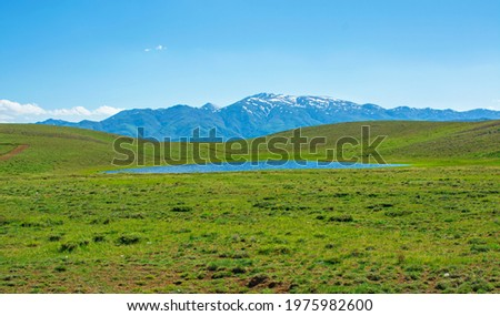 a pond formed by melting snow on the top of the mountain.nature and landscape. Stok fotoğraf ©
