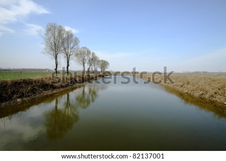 a pond under the blue sky, natural landscape, Luannan County, Hebei Province, China.