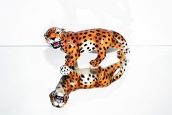 A porcelain jaguar on an isolated background