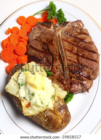 A porterhouse (or T-bone) steak served with baked potato and boiled carrots, viewed from above