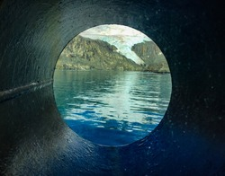 A porthole view of South Georgia Island in the Southern Ocean