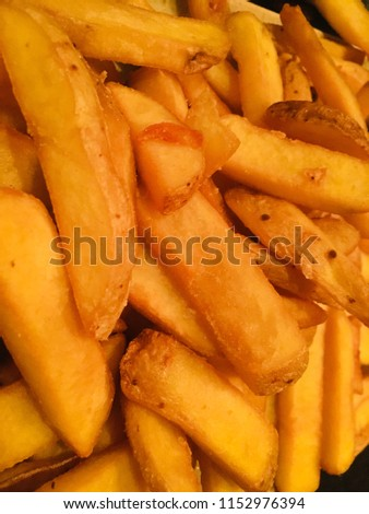 A portion of golden hot delicious french fried potatoes #1152976394