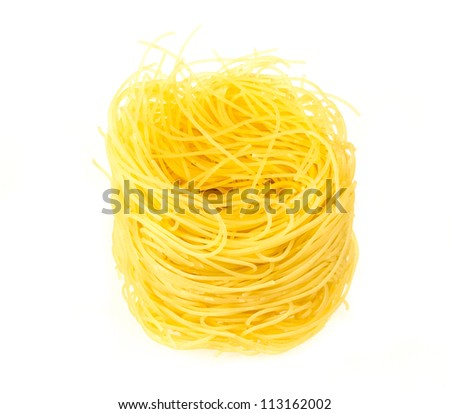 A portion of tagliatelle italian pasta isolated on white