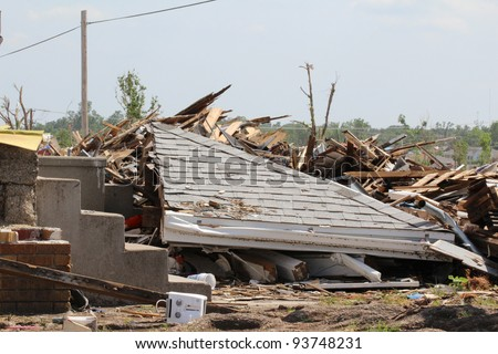 A portion of the roof of this house has collapsed onto the homes remains after an EF5 tornado ripped through the area, causing destruction of historic proportion.