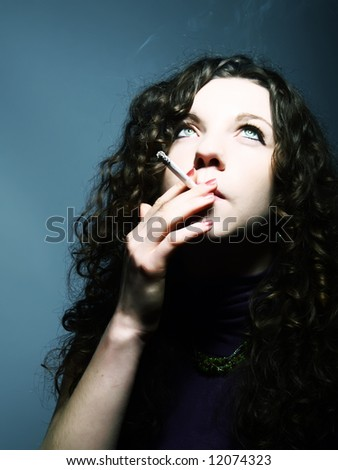 A portrait about a pretty lady with white skin and long brown wavy hair who is smoking