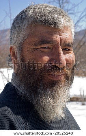 Portrait close up of the old men with grey beard. small indigenous