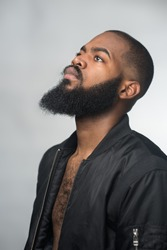 A portrait of a bearded young african man