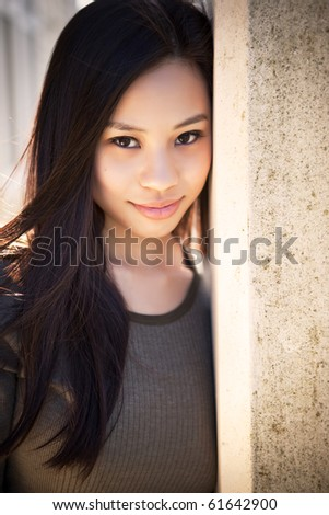 A portrait of a beautiful asian girl outdoor