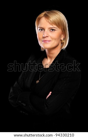 A portrait of a beautiful confident woman standing over black background