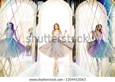 A portrait of a beautiful elegant woman in the evening dress. Fashion, evening dresses for events. #1304452063