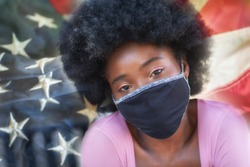 A portrait of a beautiful girl wearing face masks with the USA flag on the background.