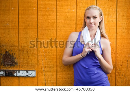 A portrait of a beautiful sporty caucasian woman  resting
