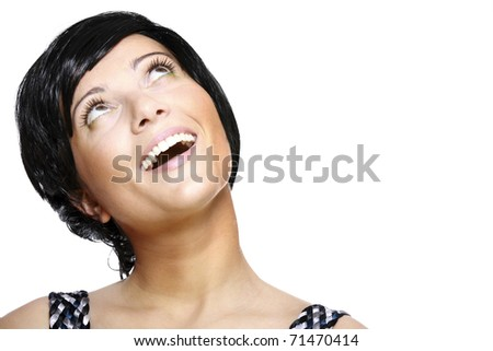 A portrait of a beautiful woman in short black hair looking up against white background