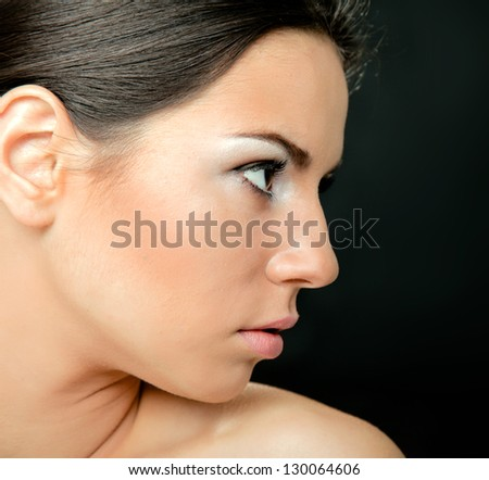 A portrait of a beautiful woman isolated on black background