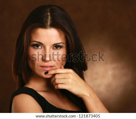A portrait of a beautiful woman isolated on brown background