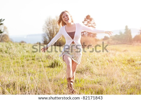 A portrait of a beautiful young Caucasian woman outdoor