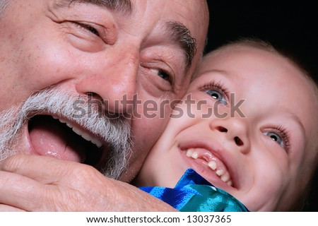 a portrait of a blond boy with grandpa