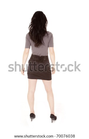 A portrait of a business woman from the back.