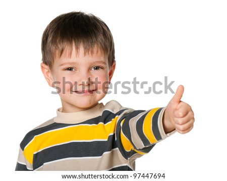A portrait of a cheerful little boy holding his thumb up; isolated on the white background
