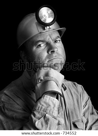 A portrait of a coal miner in black & white.