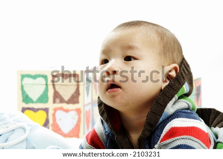 A portrait of a cute baby boy