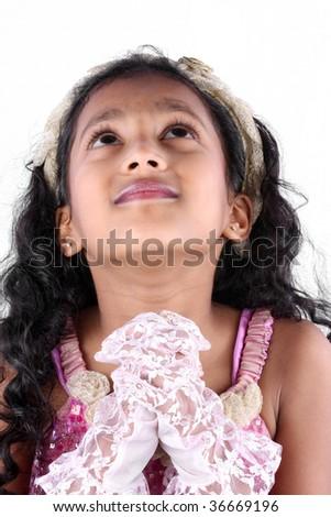 ... Indian girl praying desperately to god, on white studio background